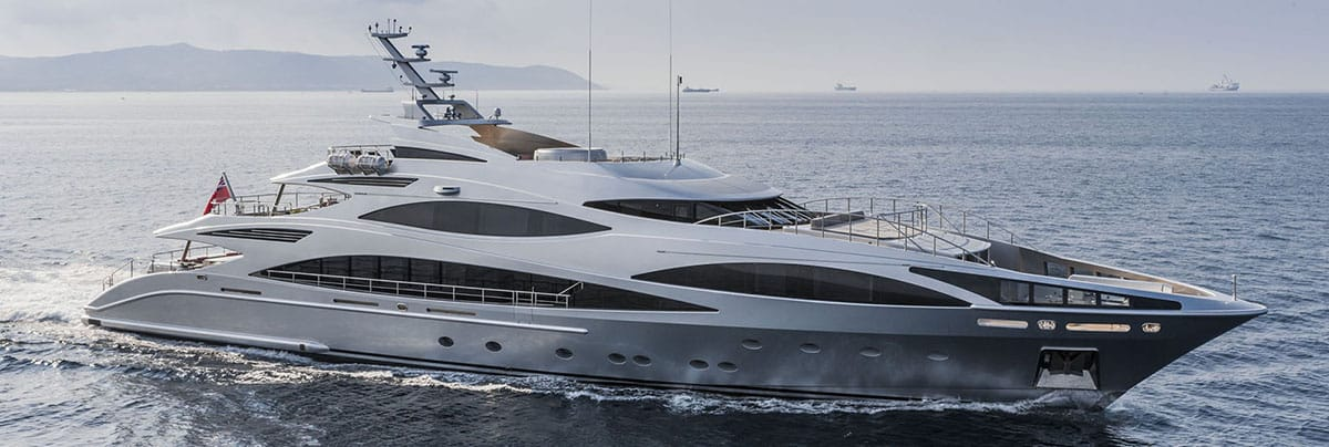 A gorgeous yacht motoring in a bay with a yacht financing company