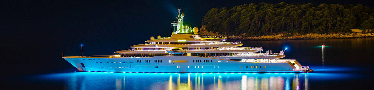 A superyacht at night, purchased through yacht financing