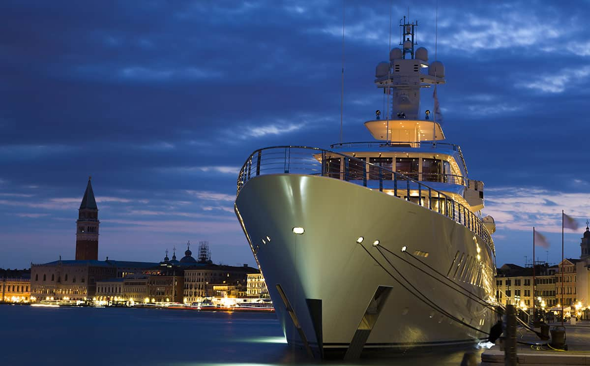 A mega yacht harbored in an European city with a yacht financing lender