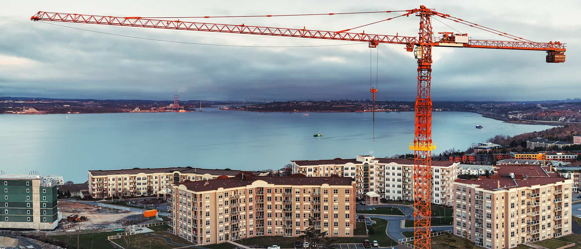 A crane over a multifamily construction site, funded by bridge financing