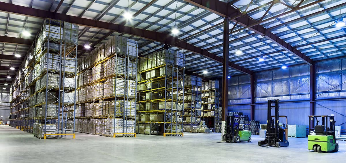 Industrial warehouse interior with numerous floor to ceiling pallets